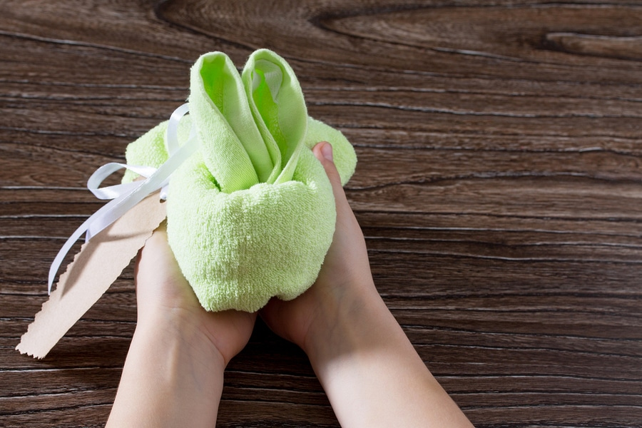 terry cloth hand towel folded into a bunny for children