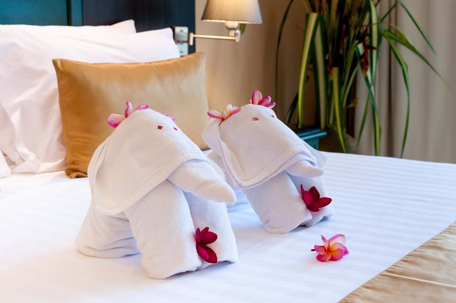 Elephant origami towel on the bed of a hotel.