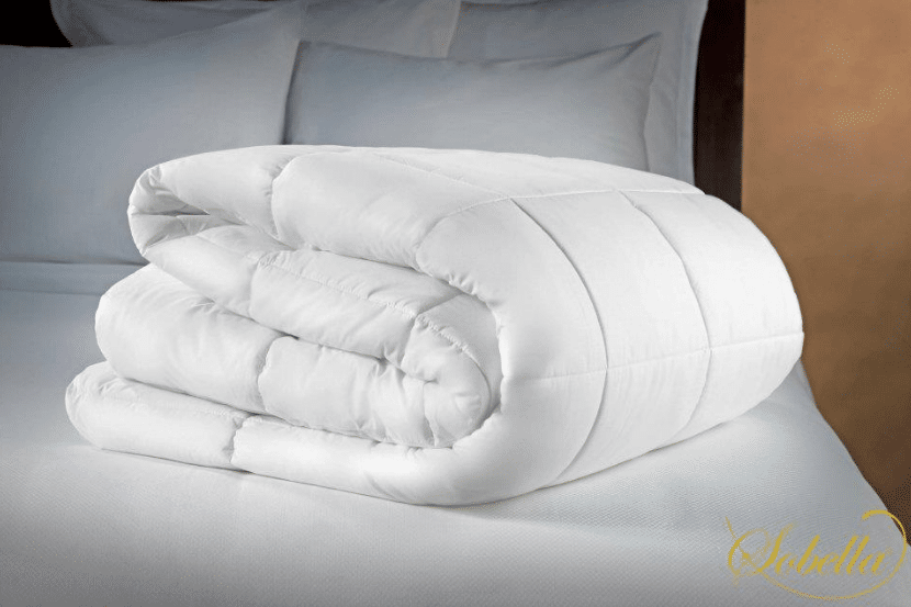 luxury sobella duvet insert white and quilted folded on a hotel bed