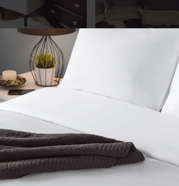 Brown Sobel Westex chenille blanket across a neatly made luxury hotel bed