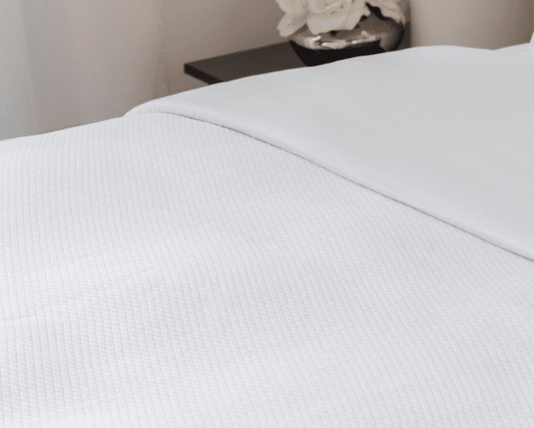 Sochic microfiber blanket by Sobel Westex on a neatly made hotel bed