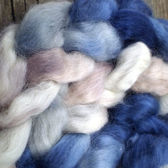 Alpaca wool blue and white wool on a wooden board