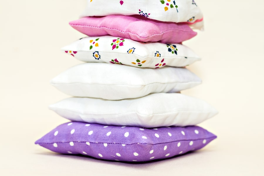 Tower of multi-colored bed pillows.