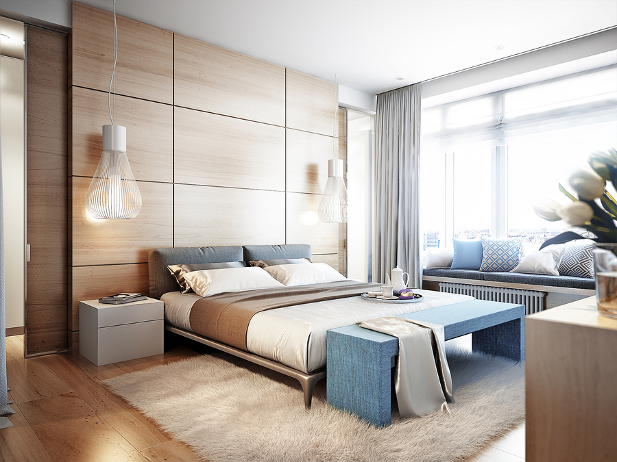 Bright and cozy modern bedroom with dressing room large window and broad window sill for read with soft seats and cushions
