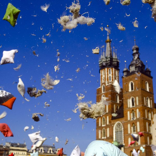 Flying pillow feathers and down during international pillow fight day