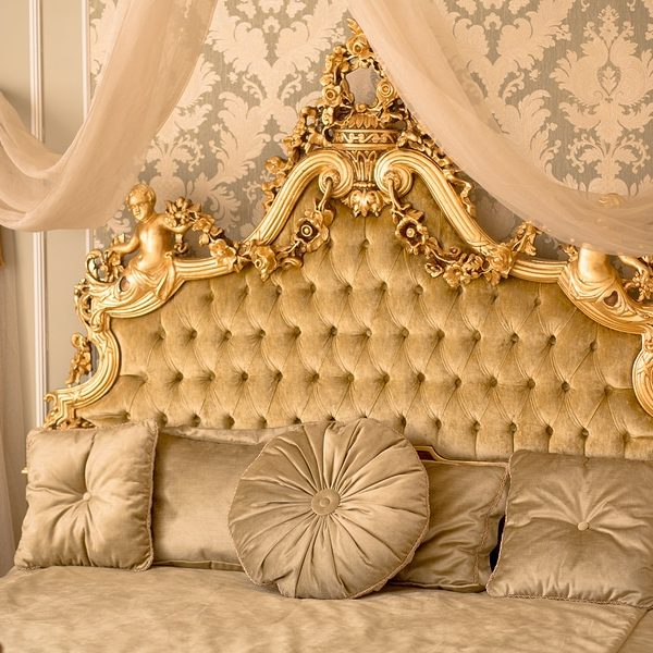 Royal bedroom interior. Interior of classic style bedroom in luxury villa. Beautiful royal and classical living room interior with a large bed in expensive apartment.
