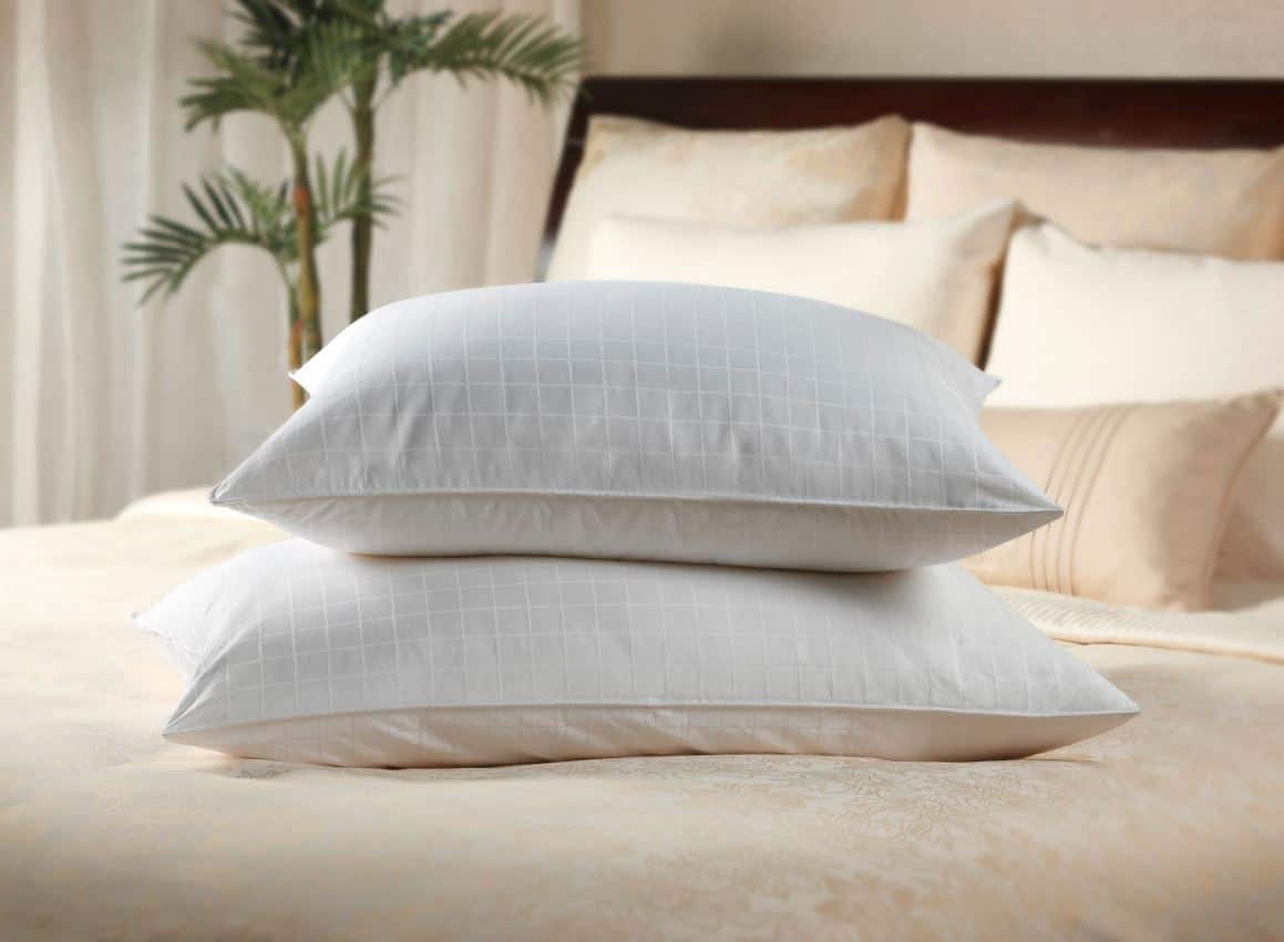 Two luxury Sobel Westex hotel pillows piled on a hotel bed
