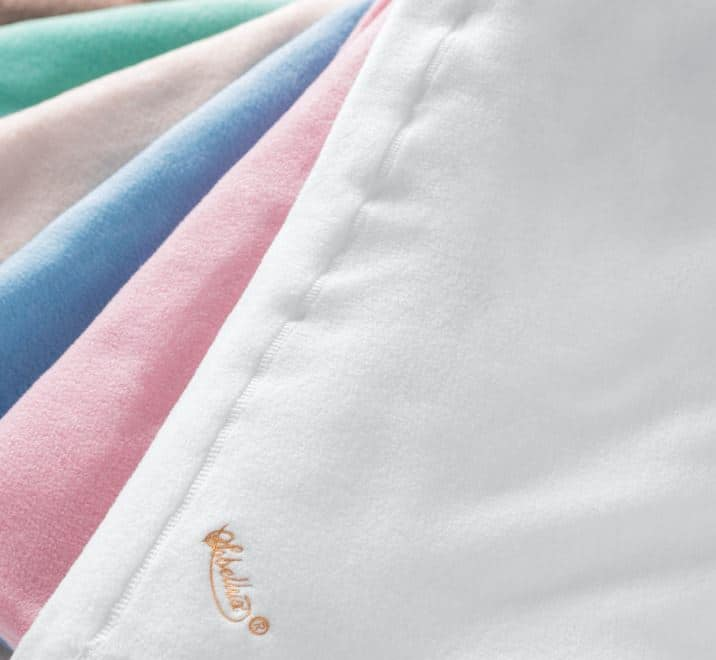 Sobel Westex fleece blankets laid out to show 5 pastel colors