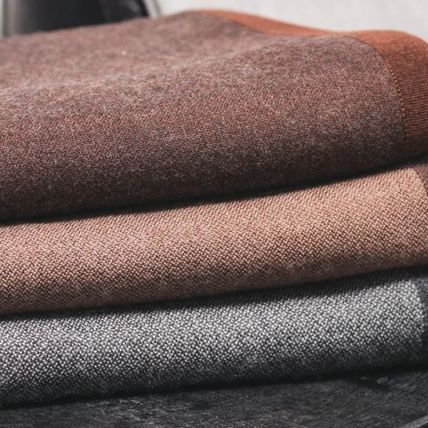 Sobel baby alpaca blankets folded in three colors