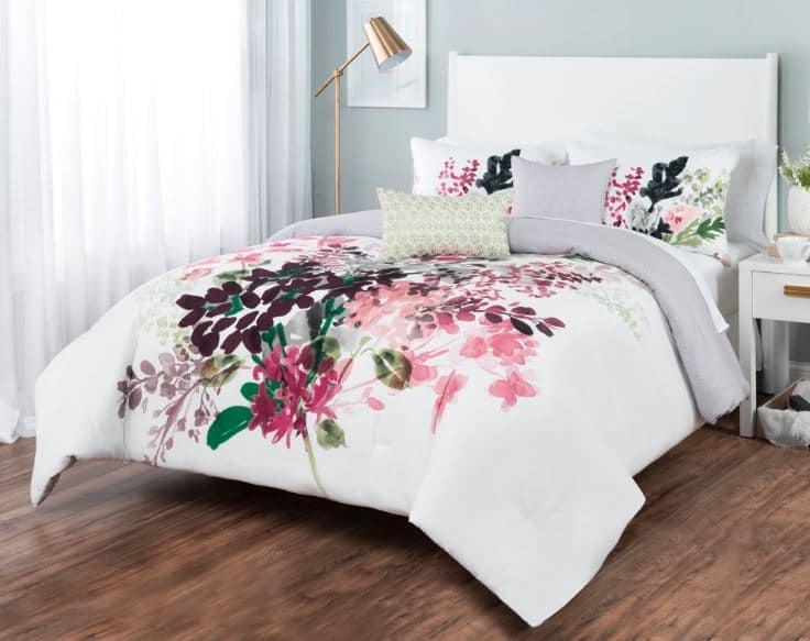 Sobel floral comforter set white with Euro style flower print displayed on a bed in a bright bedroom