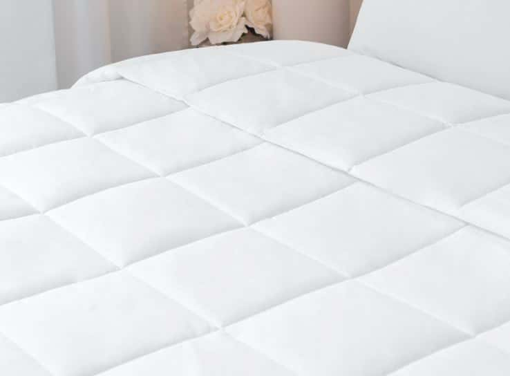 Sobella duvet luxury white quilted duvet displayed on hotel bed