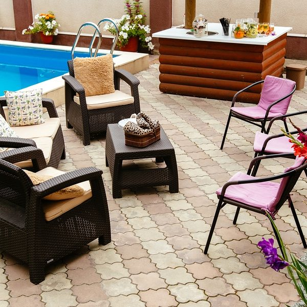 Summer pool patio furniture strawback chairs, bar and pick guest chairs in garden setting