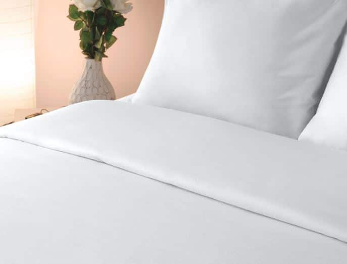 Egyptian cotton percale bed sheets by Sobel on beat hotel bed with two pillows