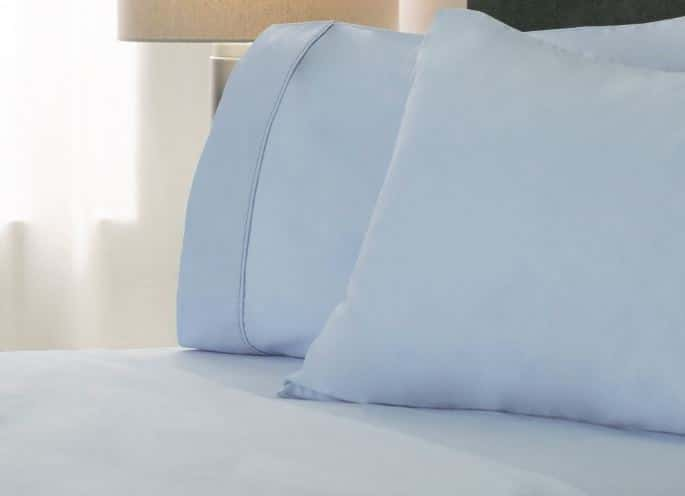 Sobella sateen luxury cotton hotel sheets in blue on hotel bed
