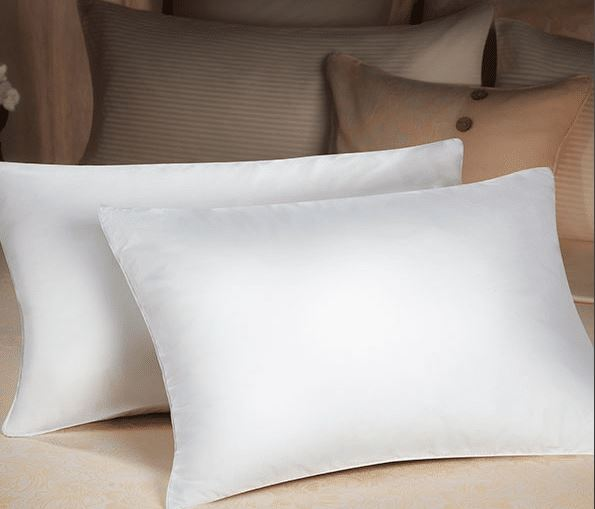 two sobel dolce vita eco pillows on bed thick and lofty