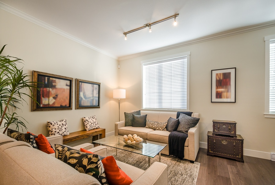 warm living room with many fall color throw pillows