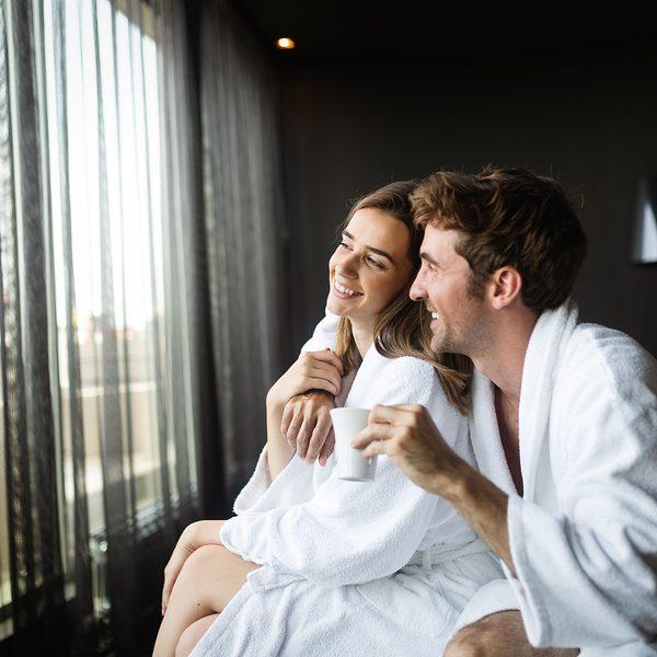 Couple wearing luxury spa robes enjoying wellness weekend and spa