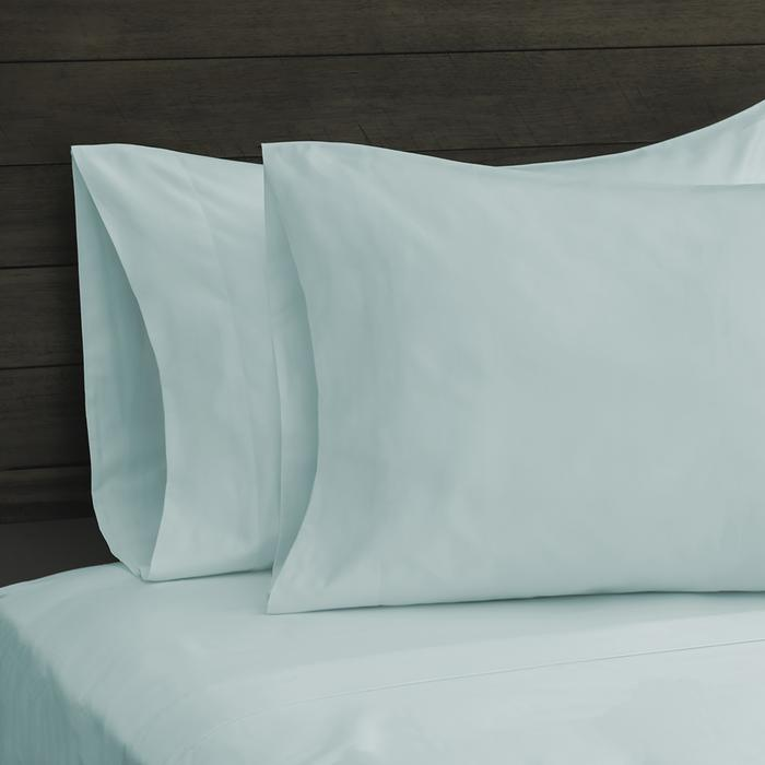 Cool blue Sobel Westex egyptian cotton sheets and pillowcases on bed
