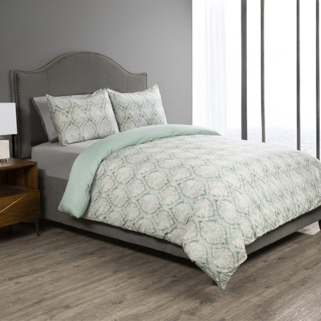 Sobel Westex Duchess of York collaboration Emerald Damask comforter set in light green and classic pattern modeled on hotel bed
