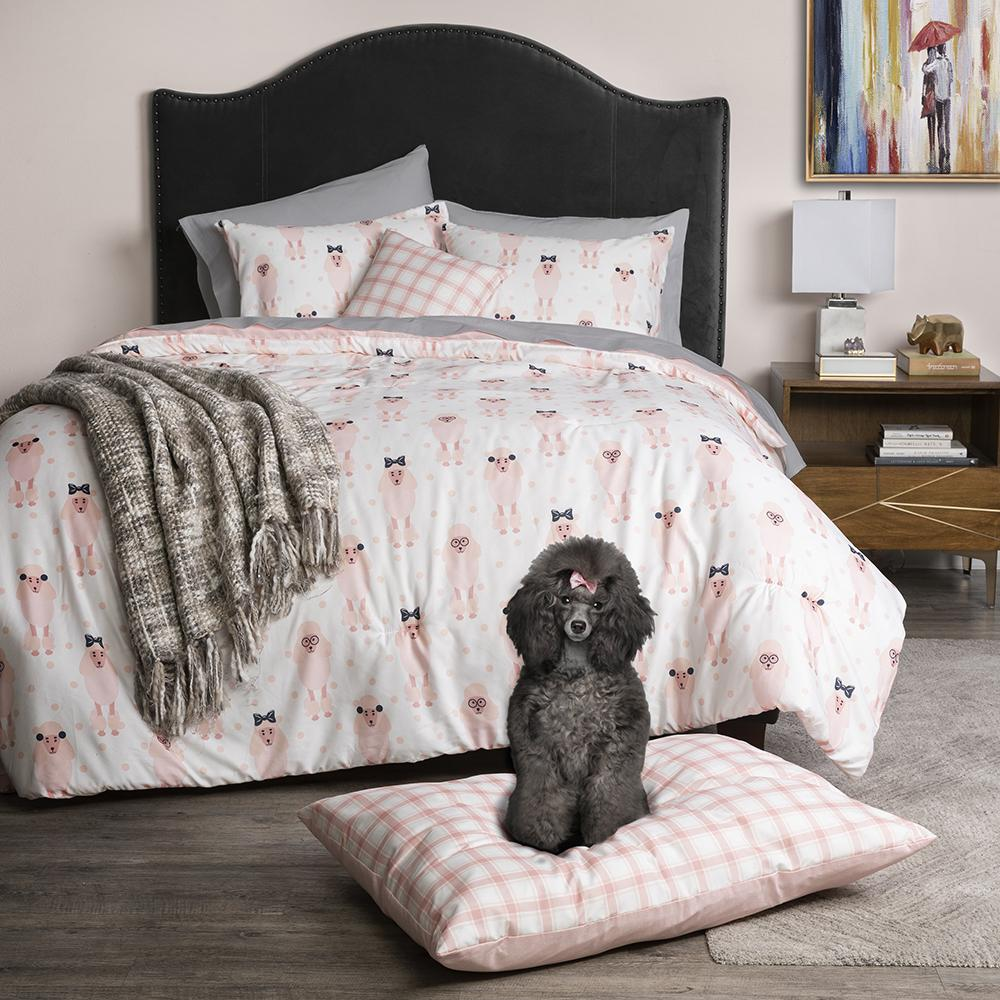 Sobel Westex and Cesar Millan collaboration series Pink Lady dog themed comforter set in pinks and grays with dog bed with poodle posing on it