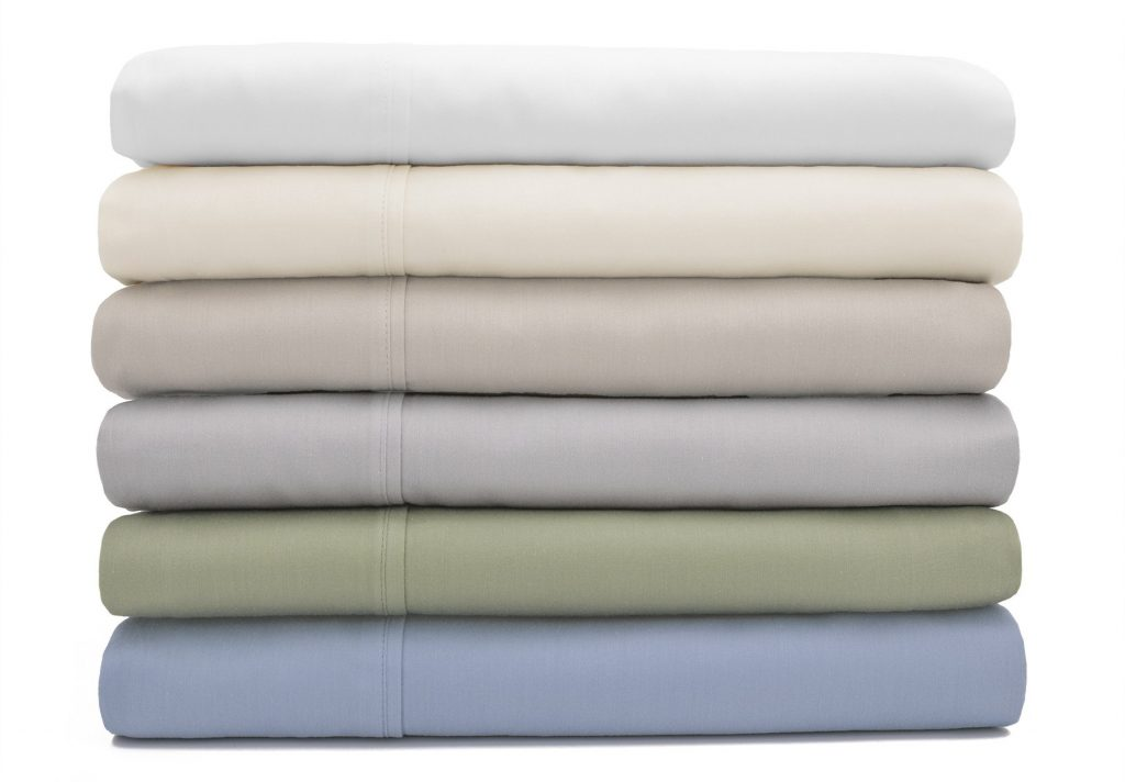 Six Dolce Notte sheet sets folded and stacked in a range of subtle colors