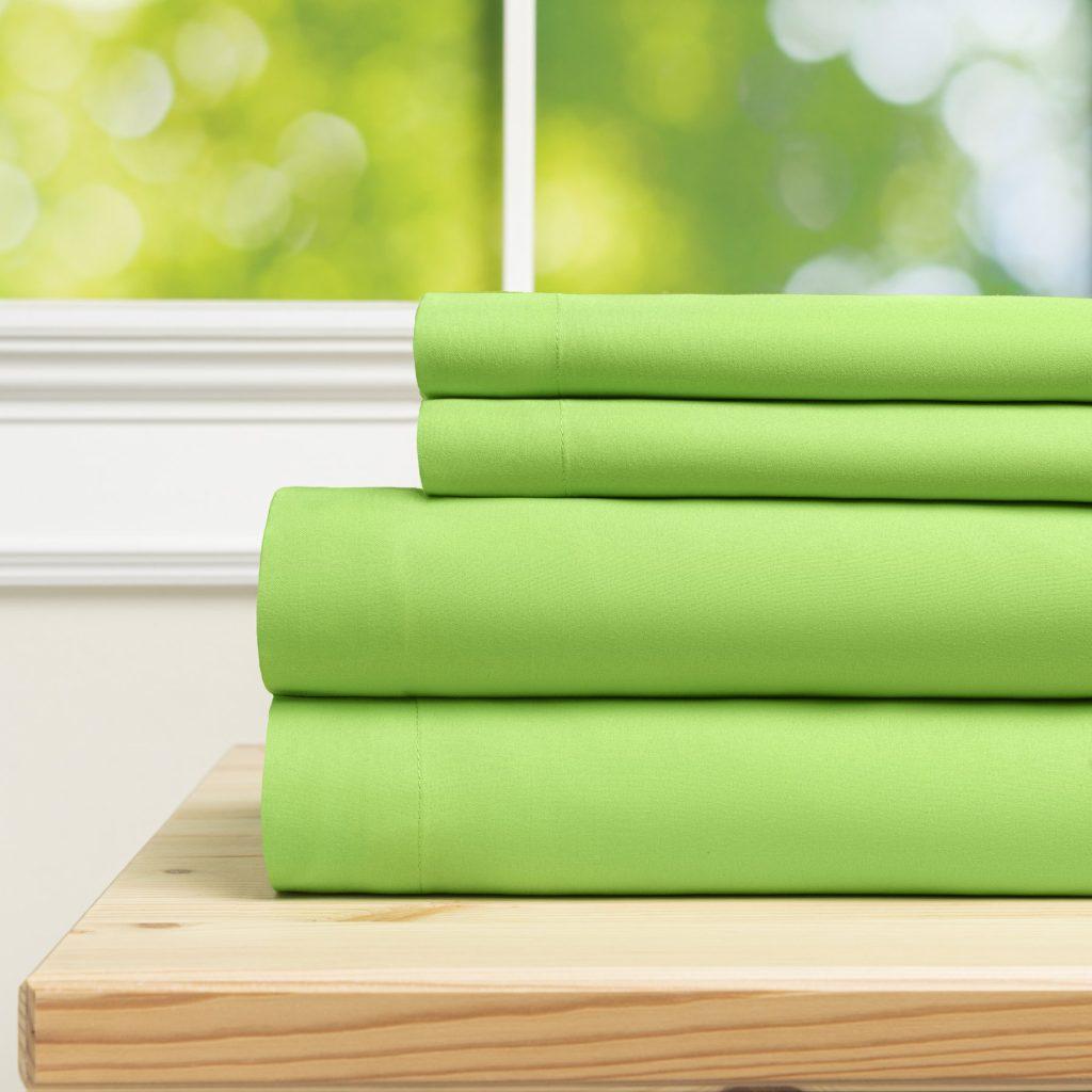 Spring green pyramid percale sheets stacked sheet set