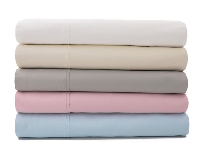 Sateen cotton sheets by Sobel Westex stacked to show five colors light blue, rose, taupe, ivory and white