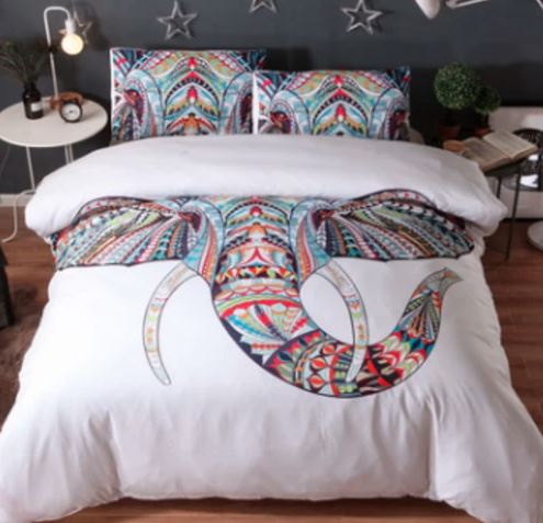 David Bromstadt White Elephant comforter set on bed colorful elephant wiht tusks on white background