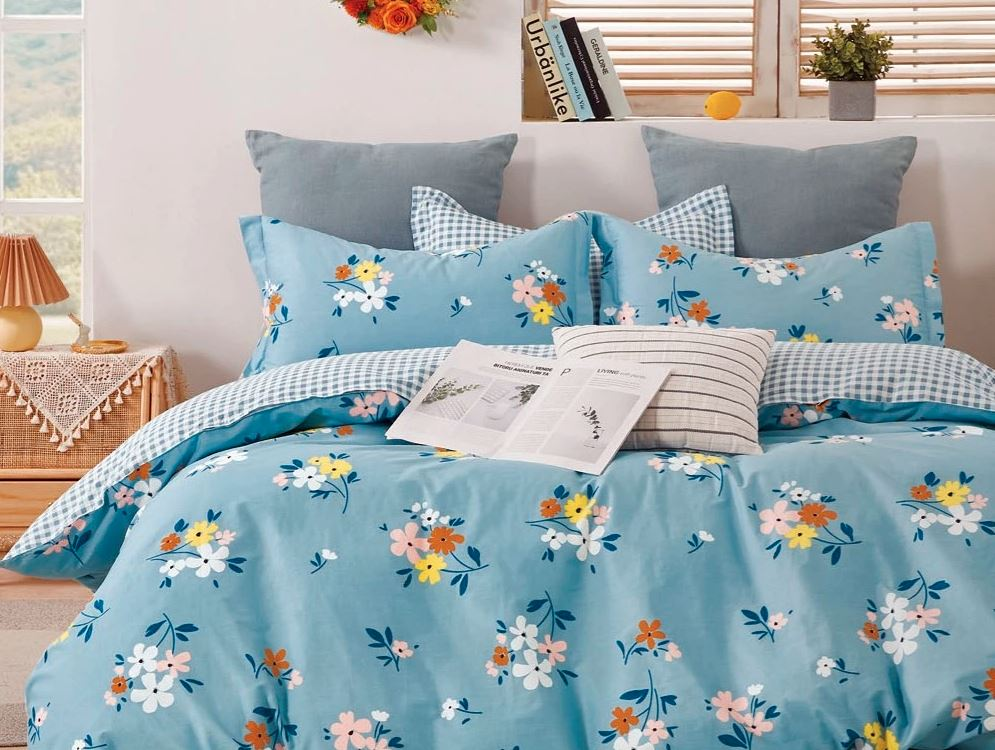 Sobel Westex Pure Elegance Blue Floral Comforter on cozy bed in a bright guest bedroom