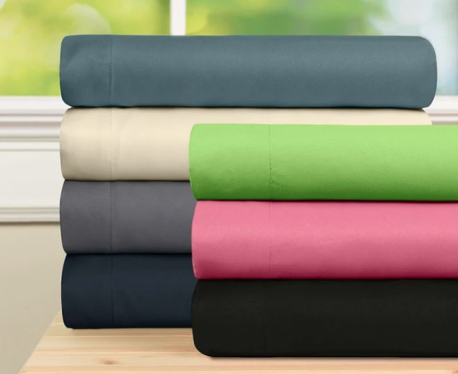Baltic Linen microfiber sheets in 8 colors folded on wooden table