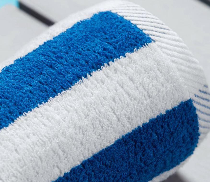 Rolled cotton bue and white striped Sobel Westex Splash beach towel