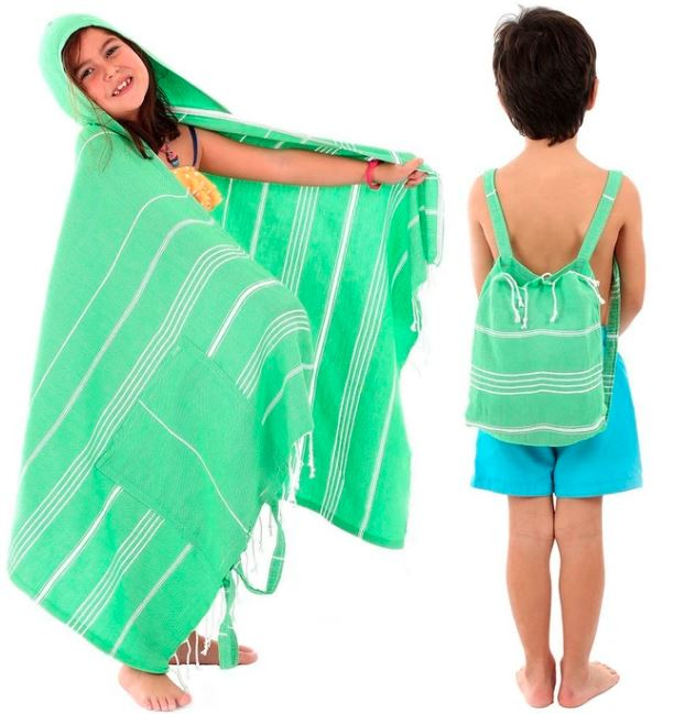 two kids modelling green stripped beach towel that doubles as a backpack