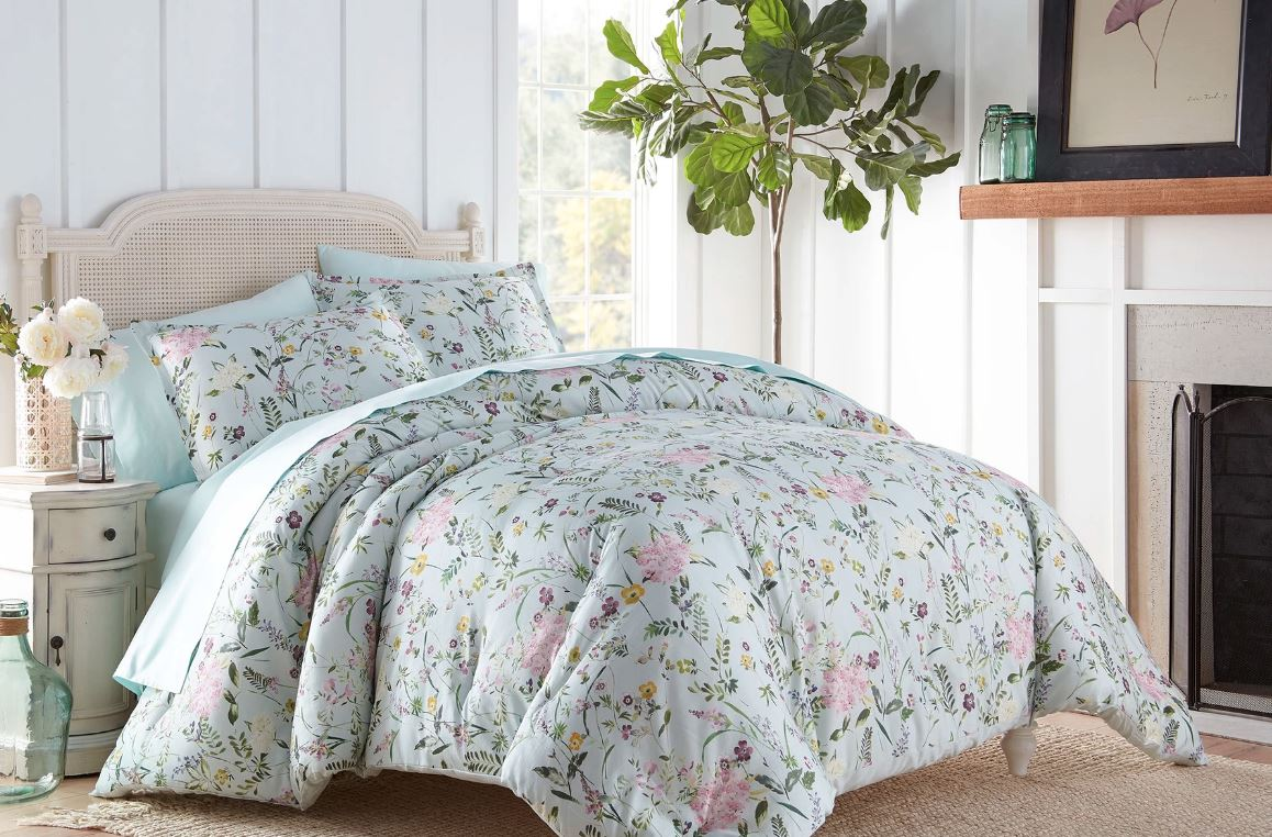 Sobel Westex Duchess Collection Apriol Buoquet Comforter Set in pink, green and purple flower patter displayed ona soft pink double bed