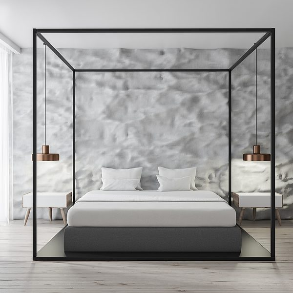 Interior of modern bedroom with white walls, concrete floor, white Egyptian cotton sheets, master bed and loft windows.